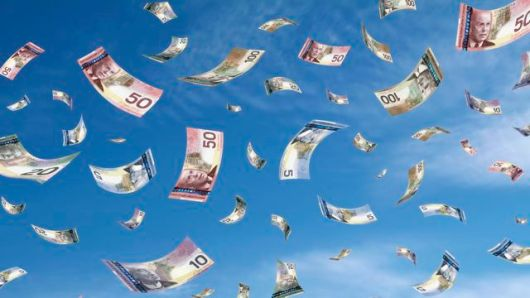 Canadian banknotes falling from sky.